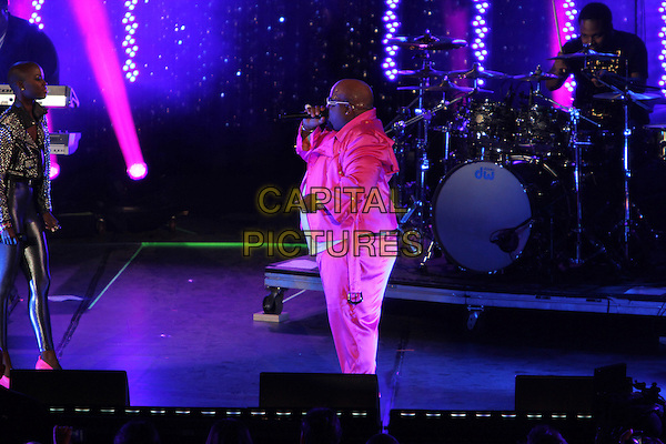 "Cee Lo Green (Thomas DeCarlo Callaway).Caesars Entertainment Kick-Off Of ""Escape To Total Rewards"" , Los Angeles Show Held At Hollywood & Highland Center, Hollywood, California, USA, 1st March 2012..music concert gig live on stage  full length pink trousers white t-shirt sunglasses singing microphone performing jacket side .CAP/ADM/KB.©Kevan Brooks/AdMedia/Capital Pictures."