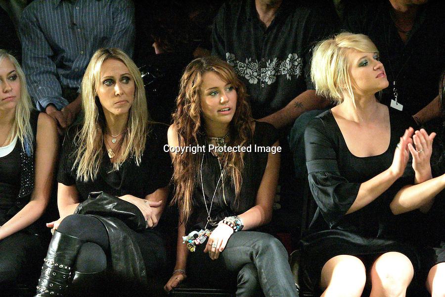 10-15-08 wed night.Christian Audigier fashion show at Smash box studios in culver city ca .Miley Cyrus was there with her boyfriend and so was Heidi Klum ..AbilityFilms@yahoo.com.805-427-3519.www.AbilityFilms.com