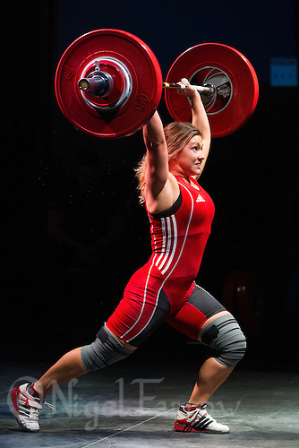 10 MAY 2014 - COVENTRY, GBR - Sarah Evans from the Swansea Weightlifting Club attempts to complete a lift during the women's 63kg category round at the British 2014 Senior Weightlifting Championships and final 2014 Commonwealth Games qualifying event round at the Ricoh Arena in Coventry, Great Britain (PHOTO COPYRIGHT © 2014 NIGEL FARROW, ALL RIGHTS RESERVED)