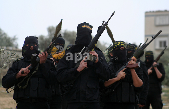 Palestinian Islamic Jihad militants train during a military exercise in Gaza City on February 10, 2009. Israel voted in a tight race between hawkish former premier Benjamin Netanyahu and centrist Foreign Minister Tzipi Livni, with the far-right set for major gains on the back of the Gaza war. Campaigning for the election, which will be crucial in determining the future of Middle East peacemaking, has been dominated by security following Israel's 22-day war on Gaza and its Hamas rulers.  APAIMAGES PHOTO / Ashraf Amra
