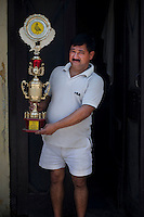 Folk sportsmen or Kabutarbaaz nurture and train pigeons to obey their commands to fly and return to home. Contests and competitions are held at the town and regional level where winners are declared Ustads and Khalifas. This folk sport is popular in North West India. Seen here is the kabutar baaz with his championship trophy