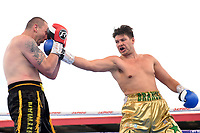 James Branch Jnr (gold shorts) defeats Jan Hrazdira during a Boxing Show at Stevenage Football Club on 18th May 2019