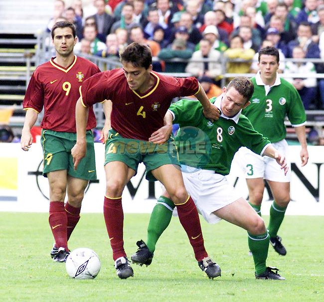 Republic of Ireland's Mark kinsella and Portugal's Roberto Severo in action in thier World Cup  2002 Qualifer match at Landsdowne Road, Dublin..Picture: Paul Mohan, Newsfile/AFP