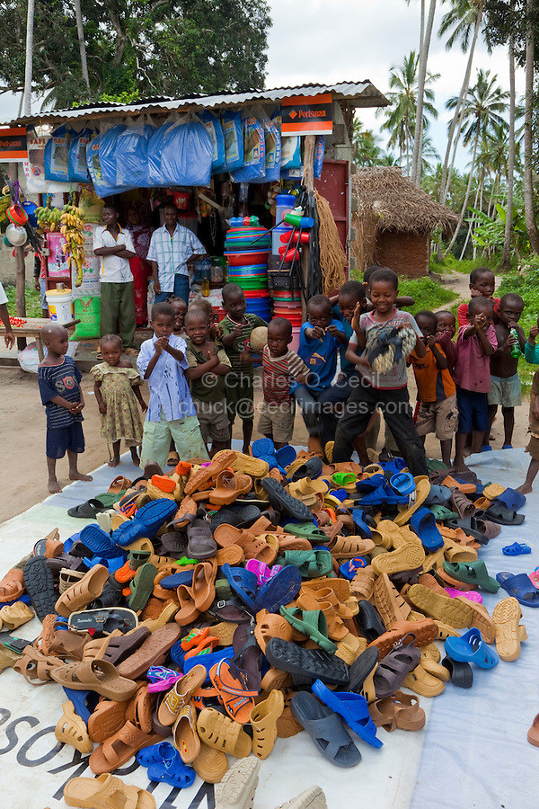 Zanzibar, Tanzania.  Roadside Shop with Shoes and Sandals for Sale.
