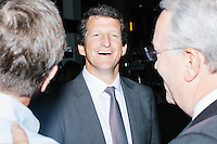 """Jay Faison, Founder and CEO of ClearPath Foundation, (center) speaks with Jack Gerard, president and CEO of the American Petroleum Institute, (right) before being on a panel put on by the Washington Post called """"Party Platform: Energy and Environment,"""" at Butcher and the Brewer outside the Republican National Convention in Cleveland, Ohio, on Tues., July 19, 2016."""