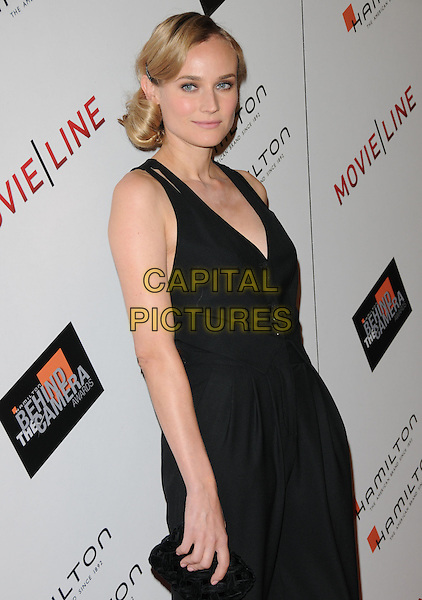 DIANE KRUGER .at The Movieline.com Presentation of The 4th Annual Hamilton Behind the Camera Awards held at The Highlands in Hollywood, California, USA, November 8th 2009..half length black sleeveless catsuit pantsuit clutch bag buttons waistcoat cut out straps .CAP/RKE/DVS           .©DVS/RockinExposures/Capital Pictures.
