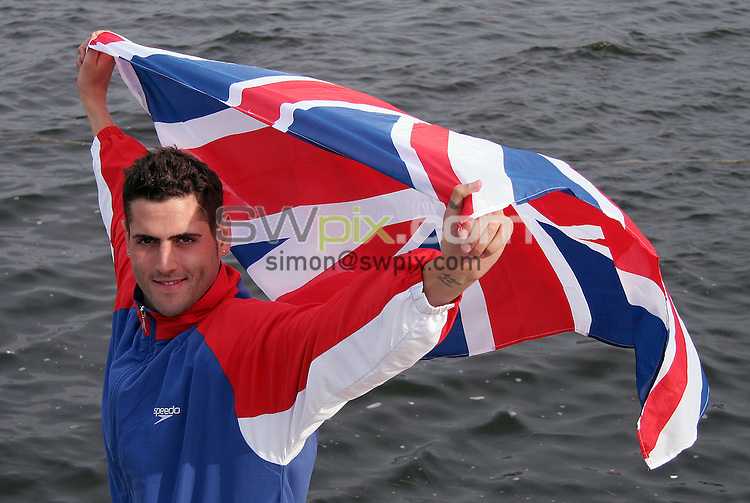 PICTURE BY VAUGHN RIDLEY/SWPIX.COM -  Swimming - Festival of Open Water Swimming - London Regatta Centre, Royal Albert Docks - London, England - 24-25/06/06...? Simon Wilkinson - 07811 267706...Alan Bircher of Great Britian, winner of the Gold Medal in the Men's 10km FINA World Cup.