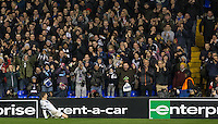 Tommy Carroll of Tottenham Hotspur celebrates his goal with a knee slide in front of the home support during the UEFA Europa League group match between Tottenham Hotspur and Monaco at White Hart Lane, London, England on 10 December 2015. Photo by Andy Rowland.
