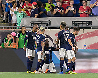 Foxborough, Massachusetts - June 30, 2018: In a Major League Soccer (MLS) match, New England Revolution (blue/white) defeated D.C. United (white/gray/red), 3-2, at Gillette Stadium.<br /> Goal celebration.