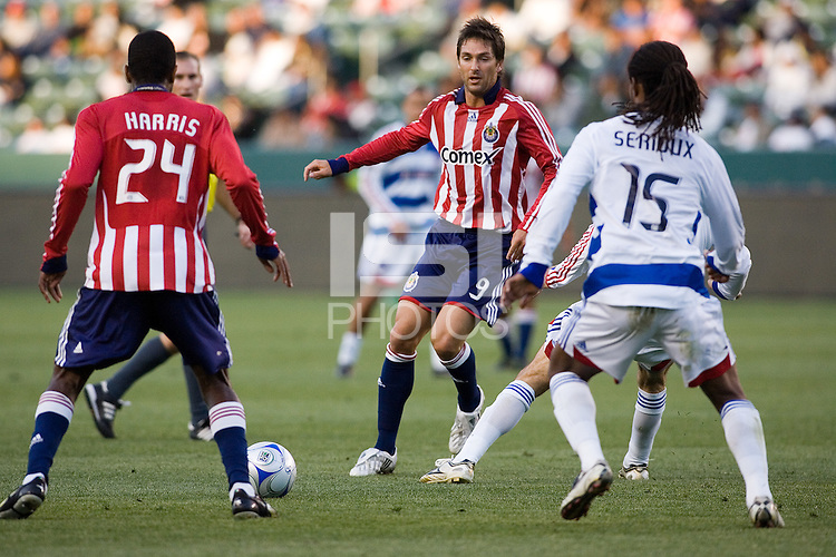 Chivas USA forwards Ante Rozov (9) and Atiba Harris (24) keep the ball away from FC Dallas defender Adrian Serioux (15) during a MLS match. FC Dallas defeated Chivas USA 2-0 at Home Depot Center Stadium, in Carson, Calif., on Sunday, April 20, 2008.