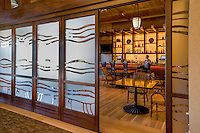 Sliding frosted glass doors into bar at California Cache Creek resort.