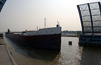 A lake freighter sails through the drawbridge, past the pit area and on to Lake Michigan by way of the Saginaw River.