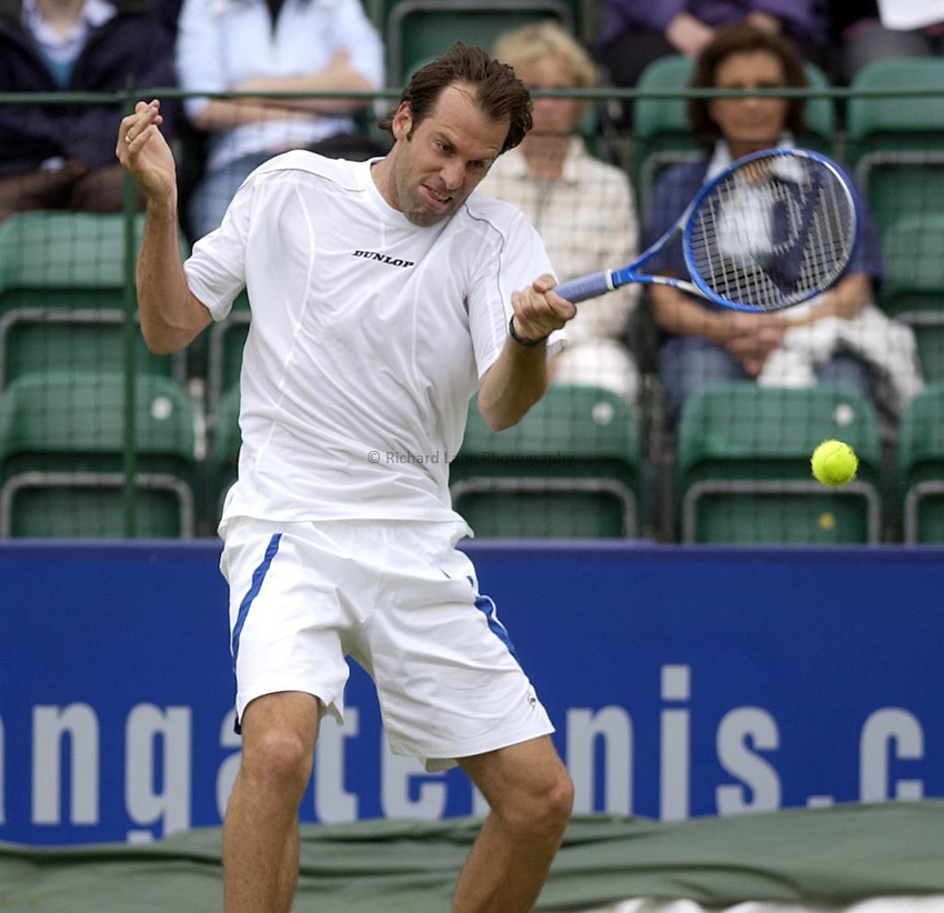 Photo. Daniel Hambury..The Surbiton Trophy..02/06/05..Greg Rusedski plays a fore hand drive on his way to a two set loss to Daniele Bracciali.