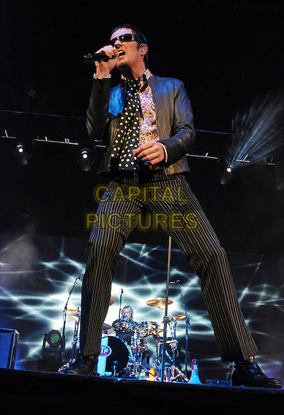 SCOTT WEILAND.Singer Scott Weiland of the Stone Temple Pilots performs during their Reunion Tour show at Copps Coliseum, Hamilton, Ontario, Canada..November 18th, 2009.stage concert live gig performance performing music microphone singing black full length leather jacket pinstripe trousers sunglasses shades polka dot scarf .CAP/ADM/TS.©Trevor Stooker/AdMedia/Capital Pictures.