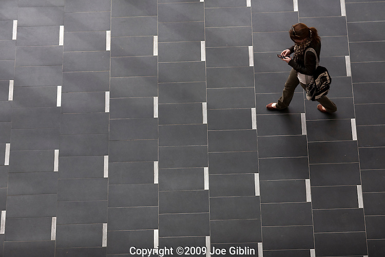 Student walks across tile floor on the campus of the University of Rhode Island. (Photo/Joe Giblin)