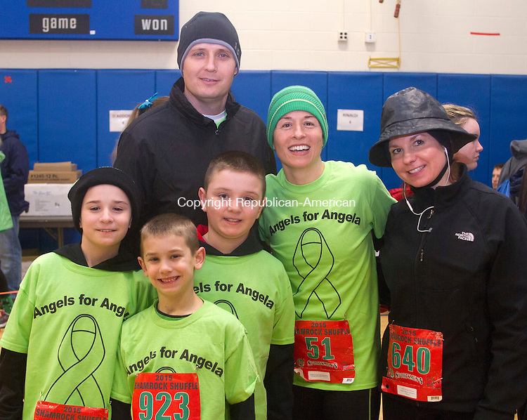 WATERTOWN, CT.- 14 MARCH 2015 - 031415JW04 - Colin Butler age 9, Vincent Tanganelli age 8, Zachary Butler age 9, Preston Butler, Margaret Butler and Jaime Bernardi pose for a photo before the start of the 4th Annual Shamrock Shuffle at Polk School Saturday morning.<br /> Jonathan Wilcox Republican-American