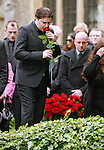 "RJ, ROBIN'S SON PLACES A ROSE ON HIS GRAVE.ROBIN GIBB FUNERAL.Robin who died after a lon-running battle with cancer aged 62, was buried at St. mary's Church , Thame, Oxfordshire..Brother Barry Gibb,65, the last surviving member of the Bee Gees was joined by family members for the funeral service..Celebrity guests who attended the funeral included Peter Andre, Tim Rice, Susan George and Leslie Phillips_08/06/2012.Mandatory Credit Photo: ©NEWSPIX INTERNATIONAL..**ALL FEES PAYABLE TO: ""NEWSPIX INTERNATIONAL""**..IMMEDIATE CONFIRMATION OF USAGE REQUIRED:.Newspix International, 31 Chinnery Hill, Bishop's Stortford, ENGLAND CM23 3PS.Tel:+441279 324672  ; Fax: +441279656877.Mobile:  07775681153.e-mail: info@newspixinternational.co.uk"