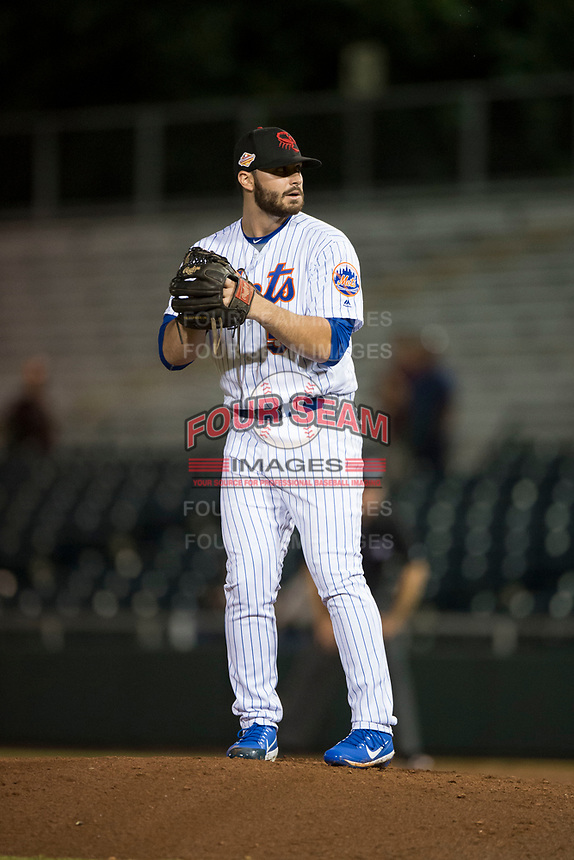 Scottsdale Scorpions relief pitcher Joe Zanghi (54), of the New York Mets organization, gets ready to deliver a pitch during an Arizona Fall League game against the Mesa Solar Sox on October 9, 2018 at Scottsdale Stadium in Scottsdale, Arizona. The Solar Sox defeated the Scorpions 4-3. (Zachary Lucy/Four Seam Images)