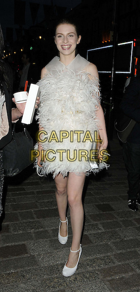 Tali Lennox.departed the Royal Academy Summer Exhibition 2012 preview party, Royal Academy of Arts, Burlington House, Piccadilly, London, England..May 30th, 2012.full length white dress feathers ankle strap shoes silver clutch bag.CAP/CAN.©Can Nguyen/Capital Pictures.