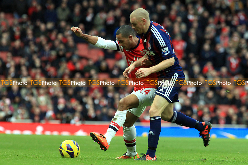 Theo Walcott of Arsenal shields the ball from Andy Wilkinson of Stoke - Arsenal vs Stoke City - Barclays Premier League Football at the Emirates Stadium, London - 02/02/13 - MANDATORY CREDIT: Paul Dennis/TGSPHOTO - Self billing applies where appropriate - 0845 094 6026 - contact@tgsphoto.co.uk - NO UNPAID USE.
