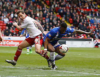 Sheffield United v Gillingham .Sky Bet League 1 ....... uniteds Bill Sharp tangles with Gills Deji Oshilaja