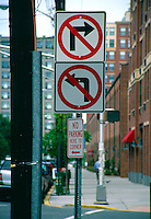 A series of traffic signs giving conflicting directions in Hoboken, New Jersey