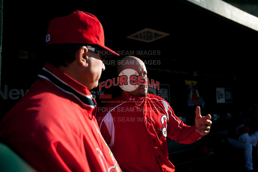 Nick Derba (31) of the Springfield Cardinals talks with Pitching Coach Bryan Eversgerd (34) during a game against the Frisco RoughRiders on April 16, 2011 at Hammons Field in Springfield, Missouri.  Photo By David Welker/Four Seam Images