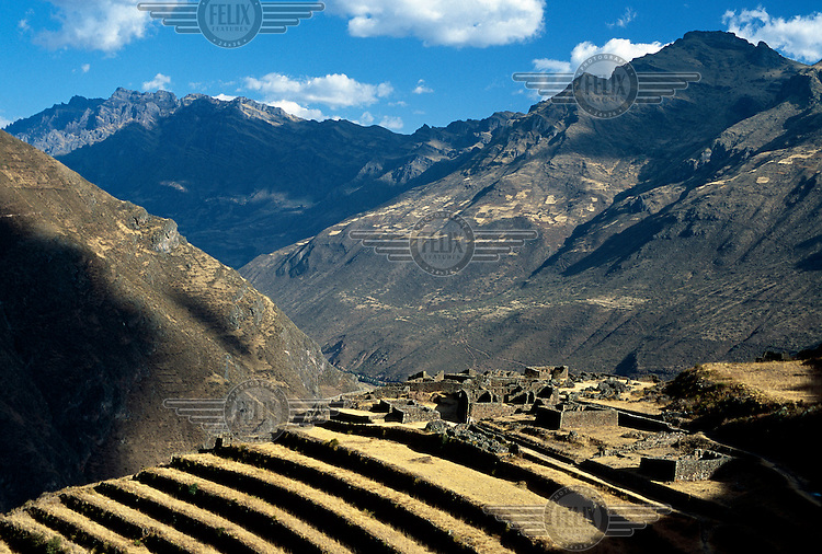 Agricultural terraces and ruins that are part of the Inca Machu Pichu complex.