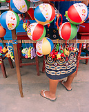 PERU, Amazon Rainforest, South America, Latin America, low section of a lady selling toys in market.