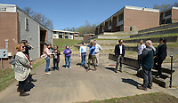 NWA Democrat-Gazette/ANDY SHUPE<br /> Deniece Smiley (center), Fayetteville Housing Authority director, leads a tour Friday, March 30, 2018, of Willow Heights, a property that the authority directs, for the organization's board of directors and members of the public in Fayetteville. The board this year has to come up with a capital improvements plan, per U.S. Department of Housing and Urban Development regulations.