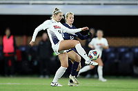 CHAPEL HILL, NC - NOVEMBER 16: MacKenzie Firek #12 of Belmont University plays the ball in front of Alexis Strickland #12 of the University of North Carolina during a game between Belmont and North Carolina at UNC Soccer and Lacrosse Stadium on November 16, 2019 in Chapel Hill, North Carolina.