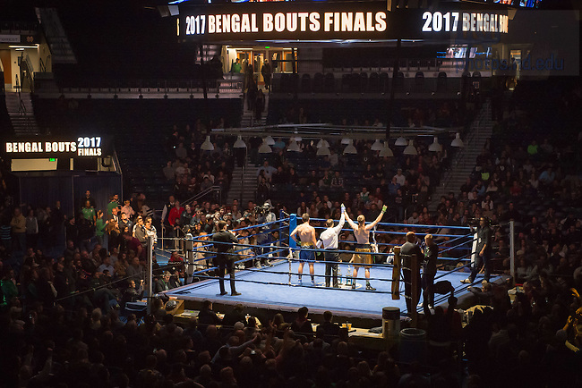 "March 3, 2017; Jack ""Not the Guy from Lost"" Shepard (gold trunks) is declared the winner by unanimous decision in the 174lb. division. (Photo by Matt Cashore/University of Notre Dame)"