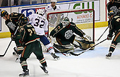 February 24th 2008:  Barry Brust (33) of the Houston Aeros makes a save as Erik Reitz (5), Joel Ward (22), Adam Taylor (32), Marco Rosa (21), and Justin Aikins (15) look for a rebound during a game vs. the Rochester Amerks at Blue Cross Arena at the War Memorial in Rochester, NY.  The Aeros defeated the Amerks 4-0.   Photo copyright Mike Janes Photography 2008