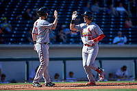 Surprise Saguaros catcher Andrew Knizner (96), of the St. Louis Cardinals organization, is congratulated by Chris Paul (21) after hitting his first home run of the game against the Mesa Solar Sox on October 20, 2017 at Sloan Park in Mesa, Arizona. The Solar Sox walked-off the Saguaros 7-6.  (Zachary Lucy/Four Seam Images)