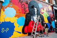 New York, NY - 3 September 2015 - Solus, of Crash and Solus, puts the finishing touches on a memorial mural for Joey Ramone, for the 40th Anniversary of punk rock club CBGB. The street mural is part of the  L.I.S.A Project whose mission it is to bring a diverse group of artists together in Little Italy on historic Mulberry Street to create Manhattan's only mural arts district. That dream has grown into a premiere public arts program reaching into SoHo, Lower Eastside, East Village, Chinatown and Chelsea.
