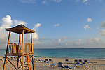 Watchtower and sun lounger on tropical beach at sunrise, Punta Cana, Dominican Republic