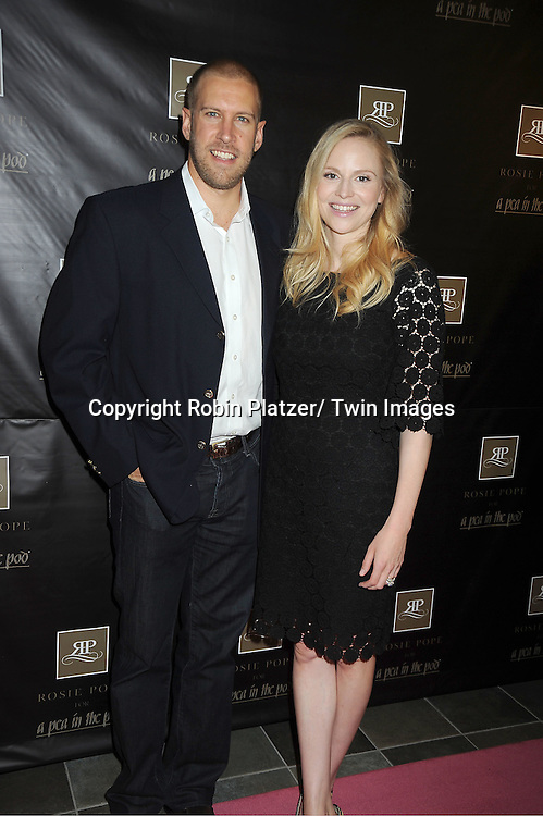 Daron Pope and wife Rosie Pope makes a  personal appearance to debut the Rosie Pope collection for A Pea in the Pod at the Destination Maternity Store in New York City on June 28, 2012.