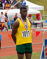 Parkview senior AJ Green stands on the awards stand after receiving his 6th place medal for the Class 4 Long Jump at the Missouri Class 3-4 State Track and Field Championships, Saturday, May 25, 2013, in Jefferson City, MO. Green had a best jump of 21-2.75.