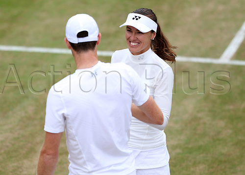 July 11th 2017, All England Lawn Tennis and Croquet Club, London, England; The Wimbledon Tennis Championships, Day 8; Martina Hingis (CHE) talking to Jamie Murray (GBR) during Martina Hingis (CHE) and Jamie Murray (GBR) versus Lucie Hradecka (CZE) and Roman Jebavy (CZE)