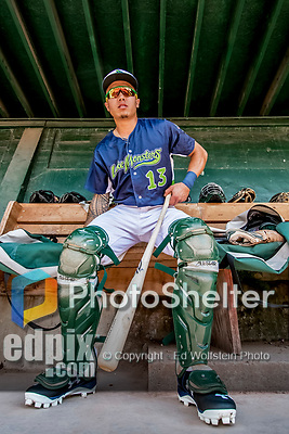 16 July 2017: Vermont Lake Monsters catcher Iolana Akau prepares his gear in the dugout prior to a start against the Auburn Doubledays at Centennial Field in Burlington, Vermont. The Monsters defeated the Doubledays 6-3 in NY Penn League action. Mandatory Credit: Ed Wolfstein Photo *** RAW (NEF) Image File Available ***