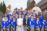 COMMUNION: Students of C.B.S. Cloun na Og making their First Holy Communion at St John Church on Saturday with their teacher Ms Emer O'Connor and Monsieur Dan Riordan.   Copyright Kerry's Eye 2008