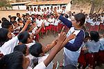 Hesti Widodo, RARE Pride Campaign Manager, conducts a quiz amongst school children, Komodo Village, Komodo National Park