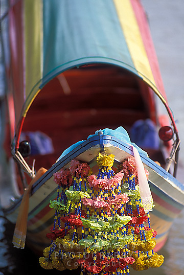 Brightly decorated bow of boat on Chao Praya River, Bangkok, Thailand