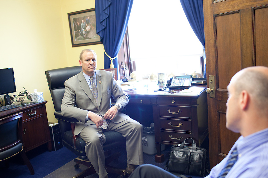 Congressman Jeff Denham (R-CA), left, is briefed by his chief of staff, Jason Larrabee in his House office in Washington, DC on August 1, 2013.