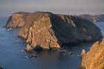 Sailboat anchored below steep coastal cliffs, Anacapa Island, Channel Islands National Park, California