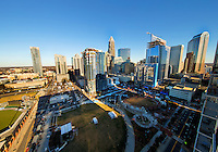 Charlotte North Carolina Skyline Photography -  The Charlotte North Carolina skyline continues to grow with several new high rise building under construction on the skyline. The photo is shot looking across Romare Bearden Park in uptown Charlotte.<br /> <br /> Charlotte Photographer- Patrick SchneiderPhoto.com