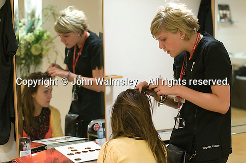 Student helping a client choose at the Arena Salon, Hair & Beauty Dept., Kingston College.