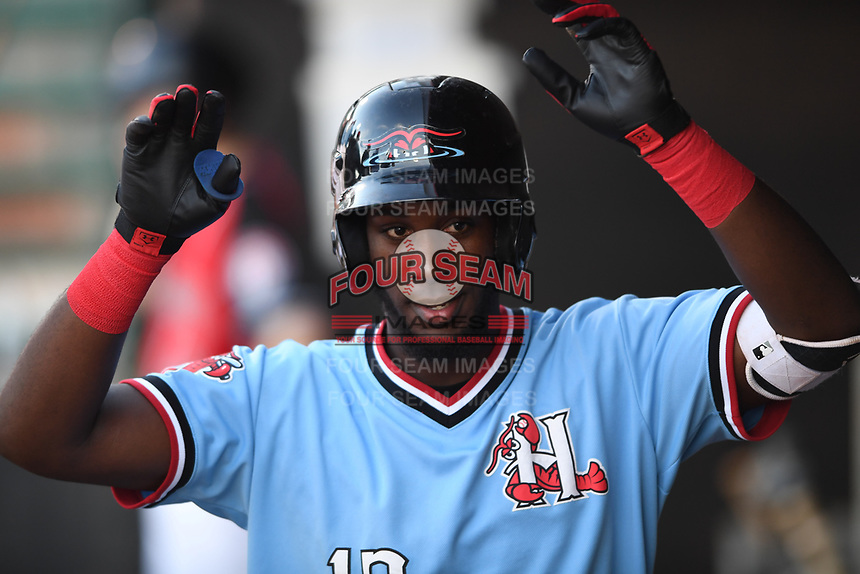 Hickory Crawdads Sherten Apostel (13) in the dugout during a game with the Asheville Tourists at L.P. Frans Stadium on May 8, 2019 in Hickory, North Carolina. The Tourists defeated the Crawdads 7-6. (Tracy Proffitt/Four Seam Images)