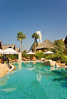 Dubai.  Pool and gardens at exclusive villa development, Beit al Bahar, attached to Jumeirah Beach Hotel..