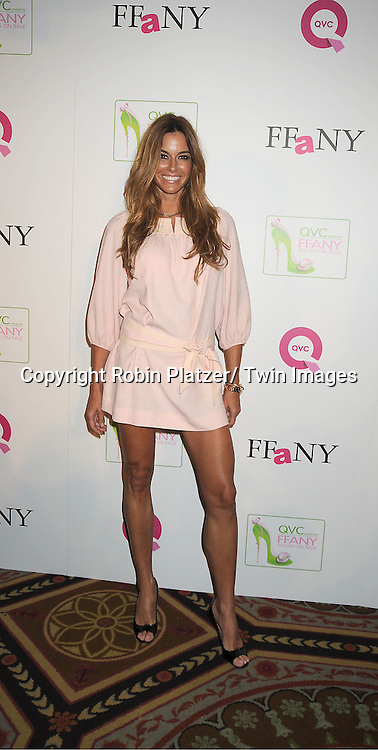 "Kelly Bensimon in pink Tracy Feith dress attends the  2011 QVC Presents ""FFANY Shoes on Sale"" Gala on October 13, 2011 at The Waldorf=Astoria Hotel in New York City. The event benefits Breast Cancer Research."